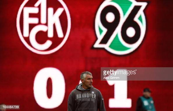 Head coach Mirko Slomka of Hannover stands in front of the video screen during the Bundesliga match between 1 FC Kaiserslautern and Hannover 96 at...