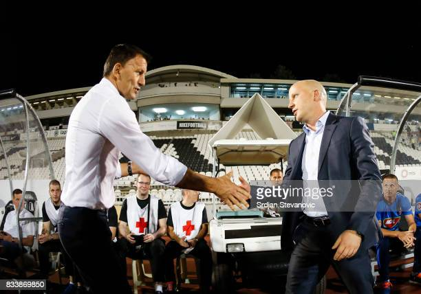 Head coach Miroslav Djukic of Partizan shake hands with the head coach Marko Nikolic of Videoton prior the UEFA Europa League Qualifying PlayOffs...