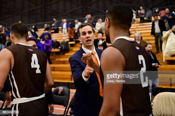 Head coach Mitch Henderson of the Princeton Tigers shakes hands with Kyle Leufroy of the Lehigh Mountain Hawks during the second half at L Stockwell...