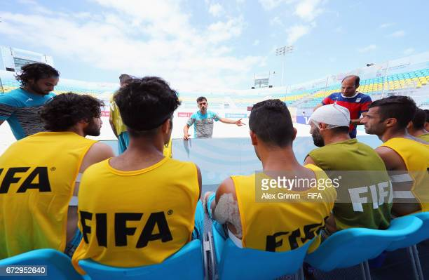Head coach Mohammad Mirshamsi talks to players during an Iran training session before the FIFA Beach Soccer World Cup Bahamas 2017 at National Beach...