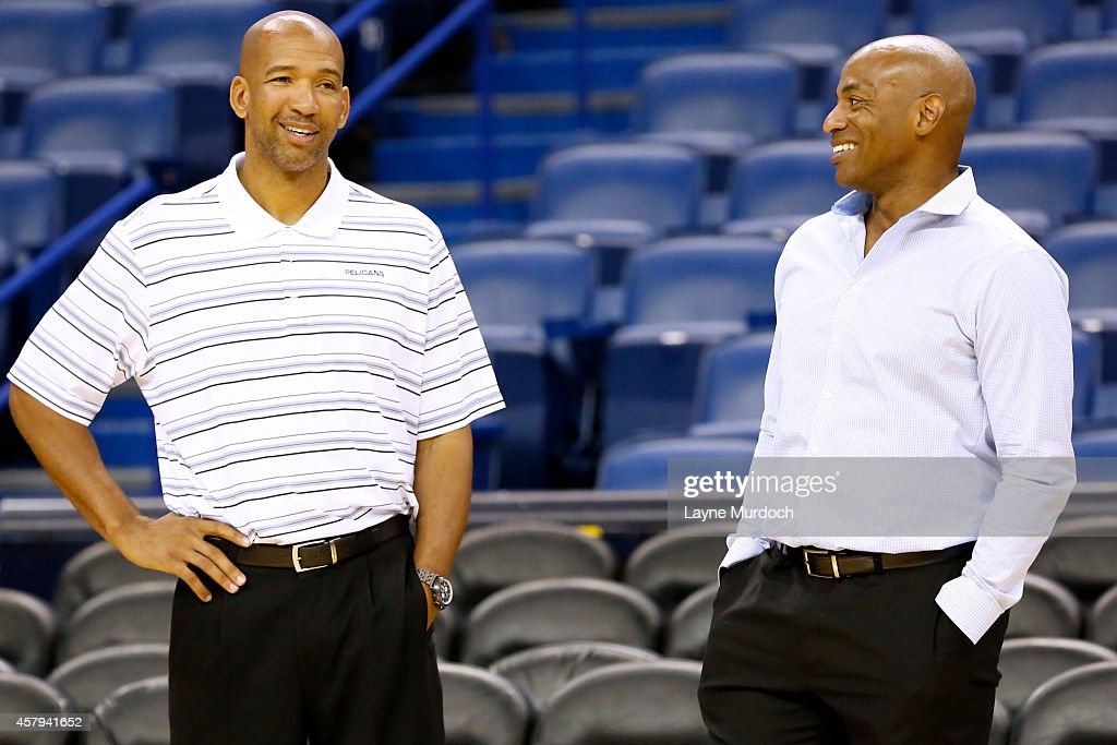 Head coach Monty Williams and General Manager Dell Demps of the New Orleans Pelicans talk during an open practice for fans on October 25 2014 at the...