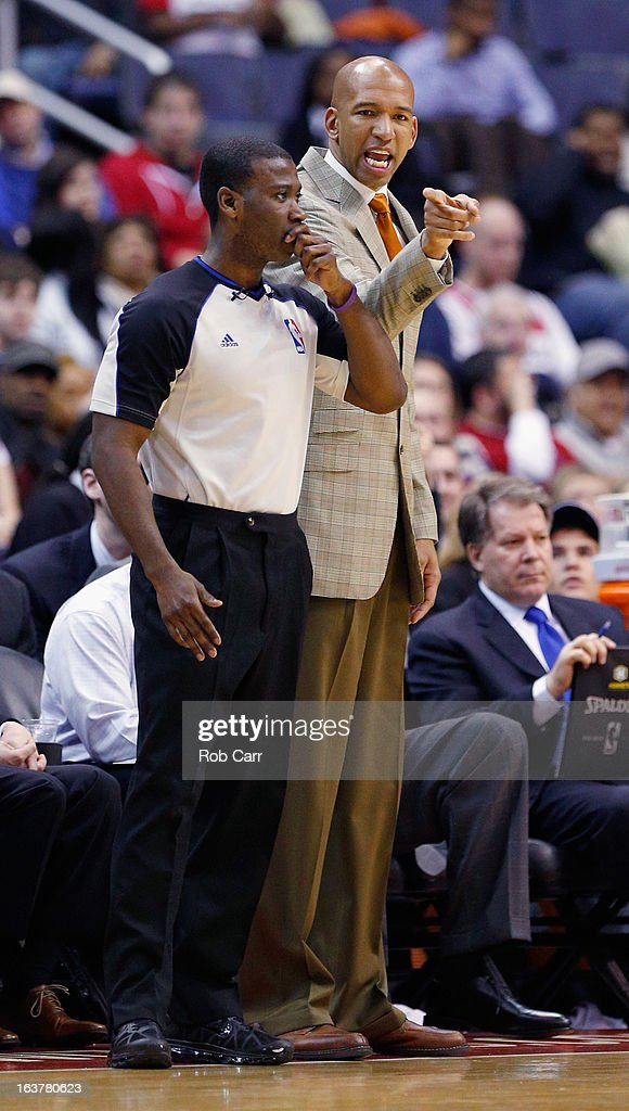 Head coach Monty Williams of the New Orleans Hornets argues a call with referee James Williams during the second half of the Hornets 96-87 loss to the Washington Wizards at Verizon Center on March 15, 2013 in Washington, DC.