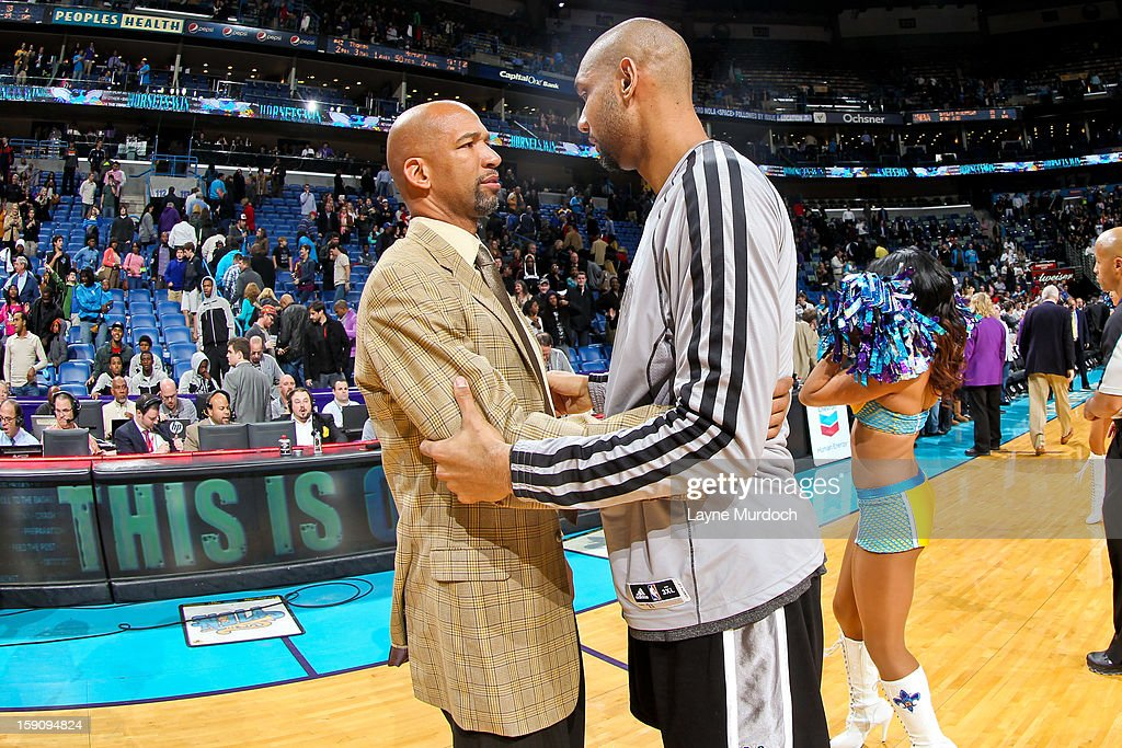 Head Coach <a gi-track='captionPersonalityLinkClicked' href=/galleries/search?phrase=Monty+Williams&family=editorial&specificpeople=220489 ng-click='$event.stopPropagation()'>Monty Williams</a> of the New Orleans Hornets greets <a gi-track='captionPersonalityLinkClicked' href=/galleries/search?phrase=Tim+Duncan&family=editorial&specificpeople=201467 ng-click='$event.stopPropagation()'>Tim Duncan</a> #21 of the San Antonio Spurs following their game on January 7, 2013 at the New Orleans Arena in New Orleans, Louisiana.