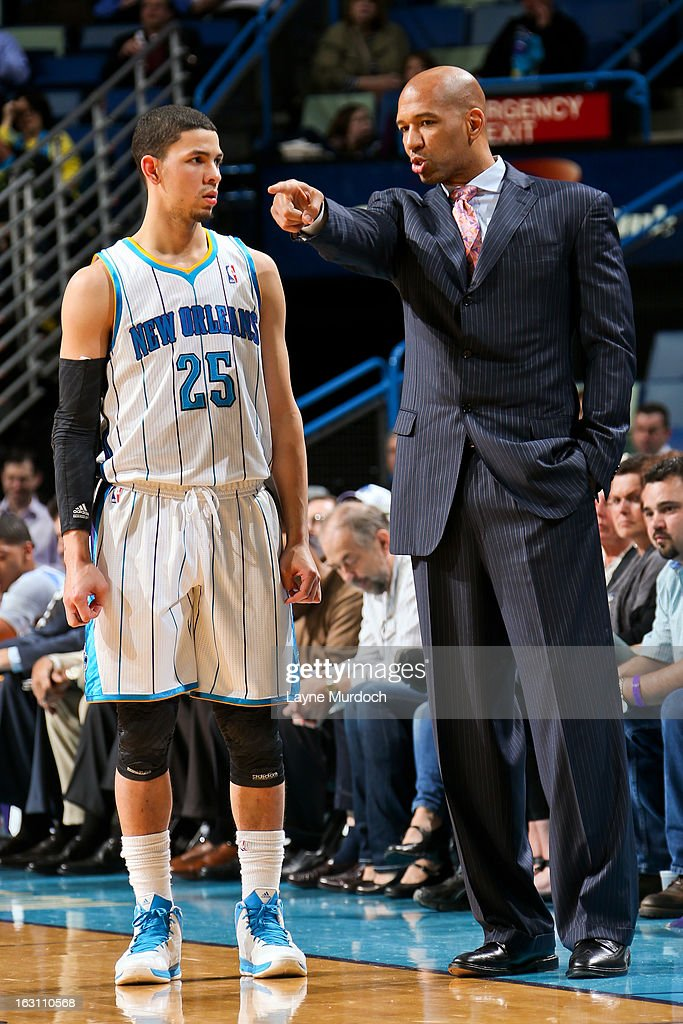 Head Coach Monty Williams of the New Orleans Hornets speaks with Austin Rivers #25 during a game against the Orlando Magic on March 4, 2013 at the New Orleans Arena in New Orleans, Louisiana.