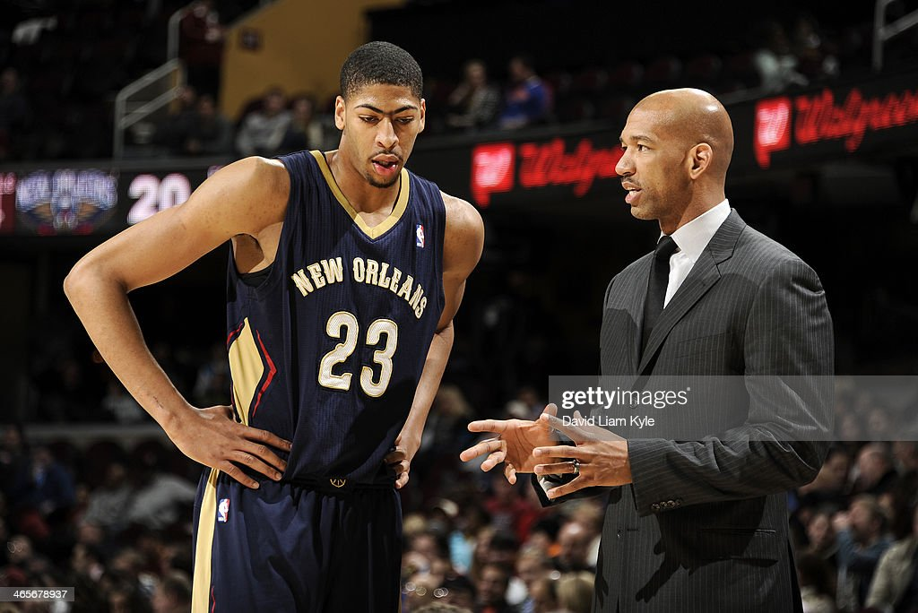 Head coach Monty Williams of the New Orleans Pelicans talks to Anthony Davis during a break in the action against the Cleveland Cavaliers at The...