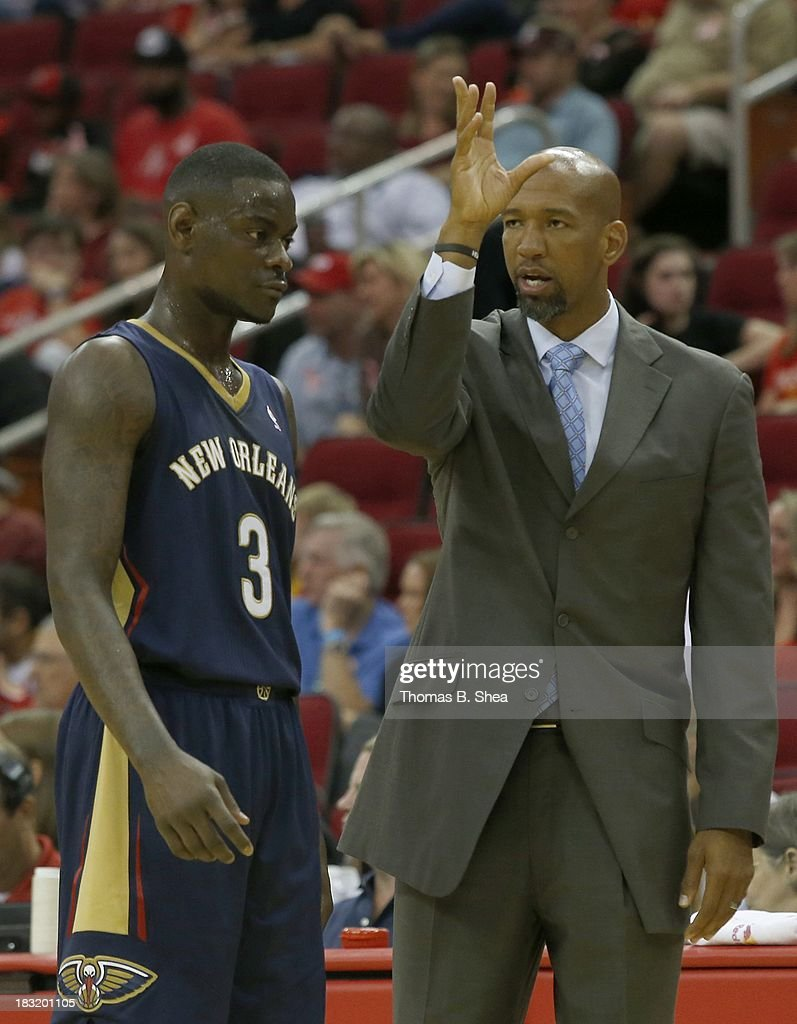 Head coach Monty Williams of the New Orleans Pelicans talks with Anthony Morrow #3 of the New Orleans Pelicans during a timeout against the Houston Rockets in a preseason NBA game on October 5, 2013 at Toyota Center in Houston, Texas. The Pelicans won 116-115.