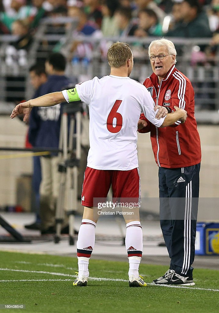 Head coach <a gi-track='captionPersonalityLinkClicked' href=/galleries/search?phrase=Morten+Olsen&family=editorial&specificpeople=687278 ng-click='$event.stopPropagation()'>Morten Olsen</a> of Denmark talks with <a gi-track='captionPersonalityLinkClicked' href=/galleries/search?phrase=Lars+Jacobsen&family=editorial&specificpeople=785080 ng-click='$event.stopPropagation()'>Lars Jacobsen</a> #6 during an international friendly match against Mexico at University of Phoenix Stadium on January 30, 2013 in Glendale, Arizona. Mexico and Denmark ended in a 1-1 draw.