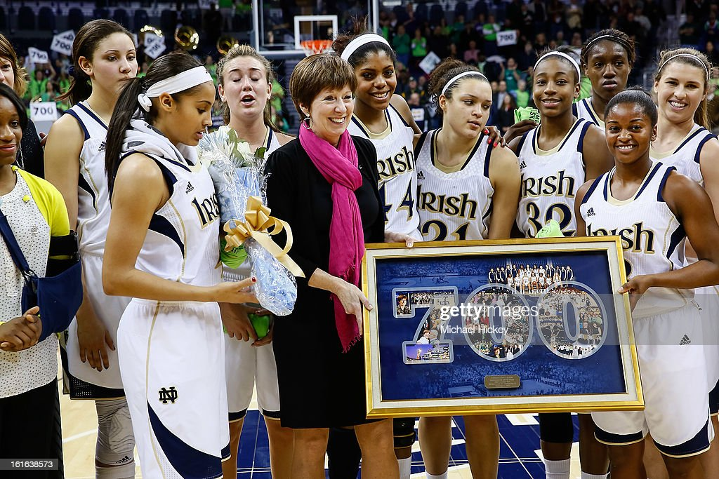 Head coach Muffet McGraw of the Notre Dame Fighting Irish is honored for her 700 wins after the game against the Louisville Cardinals at Purcel Pavilion on February 11, 2013 in South Bend, Indiana. Notre Dame defeated Louisville 93-64.