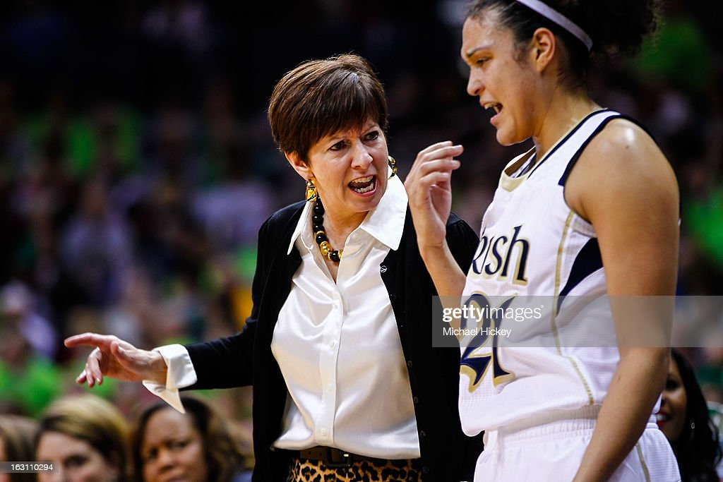 Head coach Muffet McGraw of the Notre Dame Fighting Irish talks to Kayla McBride #21 of the Notre Dame Fighting Irish during the game against the Connecticut Huskies at Purcel Pavilion on March 4, 2013 in South Bend, Indiana. Notre Dame defeated Connecticut 96-87 in triple overtime to win the Big East regular season title.