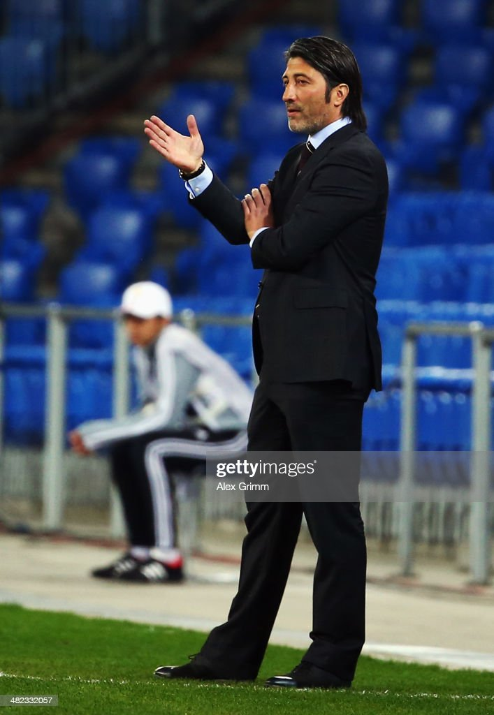 Head coach <a gi-track='captionPersonalityLinkClicked' href=/galleries/search?phrase=Murat+Yakin&family=editorial&specificpeople=2383035 ng-click='$event.stopPropagation()'>Murat Yakin</a> of Basel reacts during the UEFA Europa League Quarter Final first leg match between FC Basel 1893 and FC Valencia at St. Jakob-Park on April 3, 2014 in Basel, Switzerland.