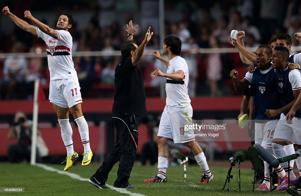 Head coach Muricy Ramalho (L) of Sao Paulo celebrates after wining the match between Sao Paulo and Santos for the Brazilian Series A 2014 at Estadio do Morumbi on August 24, 2014 in Sao Paulo, Brazil.