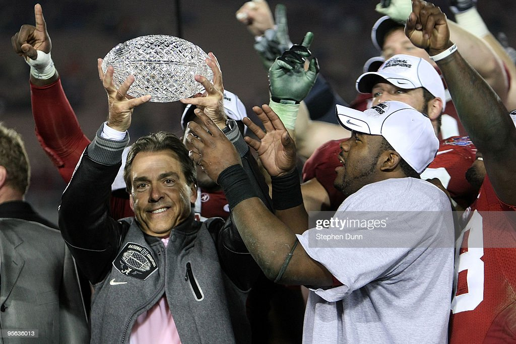 Head coach Nick Saban and running back Mark Ingram of the Alabama Crimson Tide celebrate with the BCS Championship trophy after winning the Citi BCS...