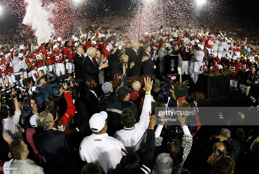 Head coach <a gi-track='captionPersonalityLinkClicked' href=/galleries/search?phrase=Nick+Saban&family=editorial&specificpeople=242860 ng-click='$event.stopPropagation()'>Nick Saban</a> and the Alabama Crimson Tide celebrate with the BCS Championship trophy after winning the Citi BCS National Championship game over the Texas Longhorns at the Rose Bowl on January 7, 2010 in Pasadena, California. The Crimson Tide defeated the Longhorns 37-21.