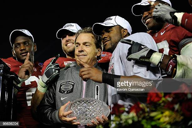 Head coach Nick Saban and the Alabama Crimson Tide celebrate with the BCS Championship trophy after winning the Citi BCS National Championship game...