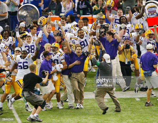 Head coach Nick Saban of LSU celebrates after defeating Oklahoma 2114 to win the National Championship at the Nokia Sugar Bowl on January 4 2004 at...