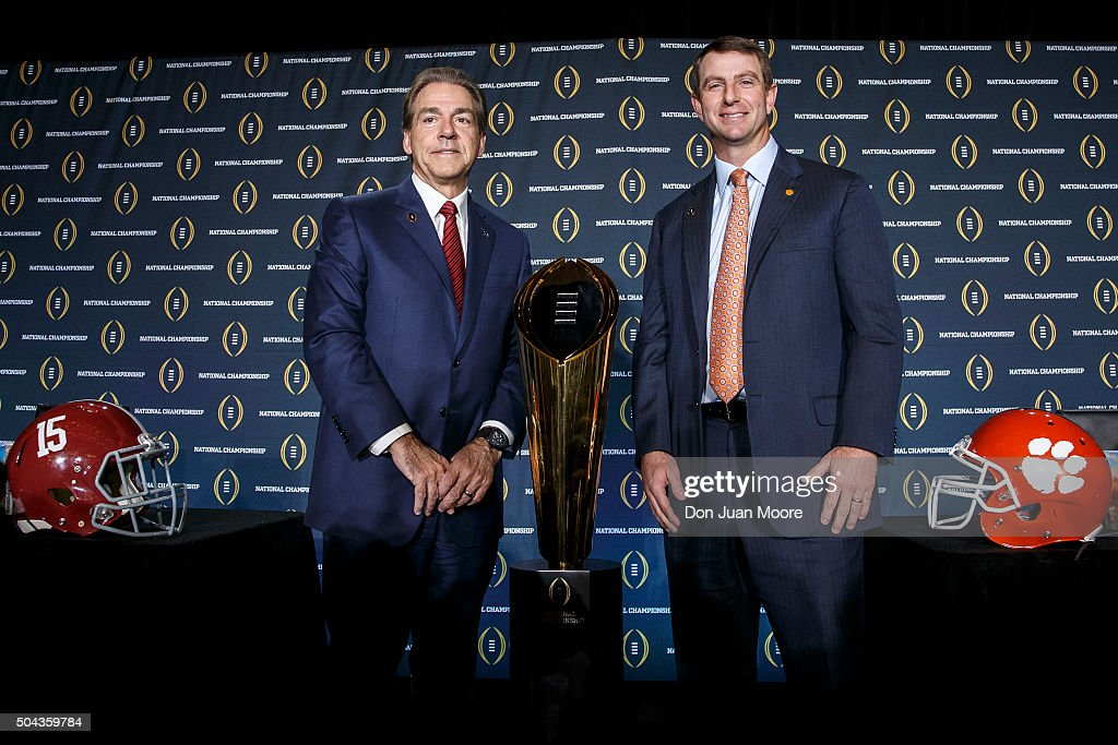 Head Coach Nick Saban of the Alabama Crimson Tide and Head Coach Dabo Swinney of the Clemson Tigers pose for the media after the Head Coaches Press...