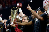Head coach Nick Saban of the Alabama Crimson Tide celebrates by hoisting the College Football Playoff National Championship Trophy after defeating...