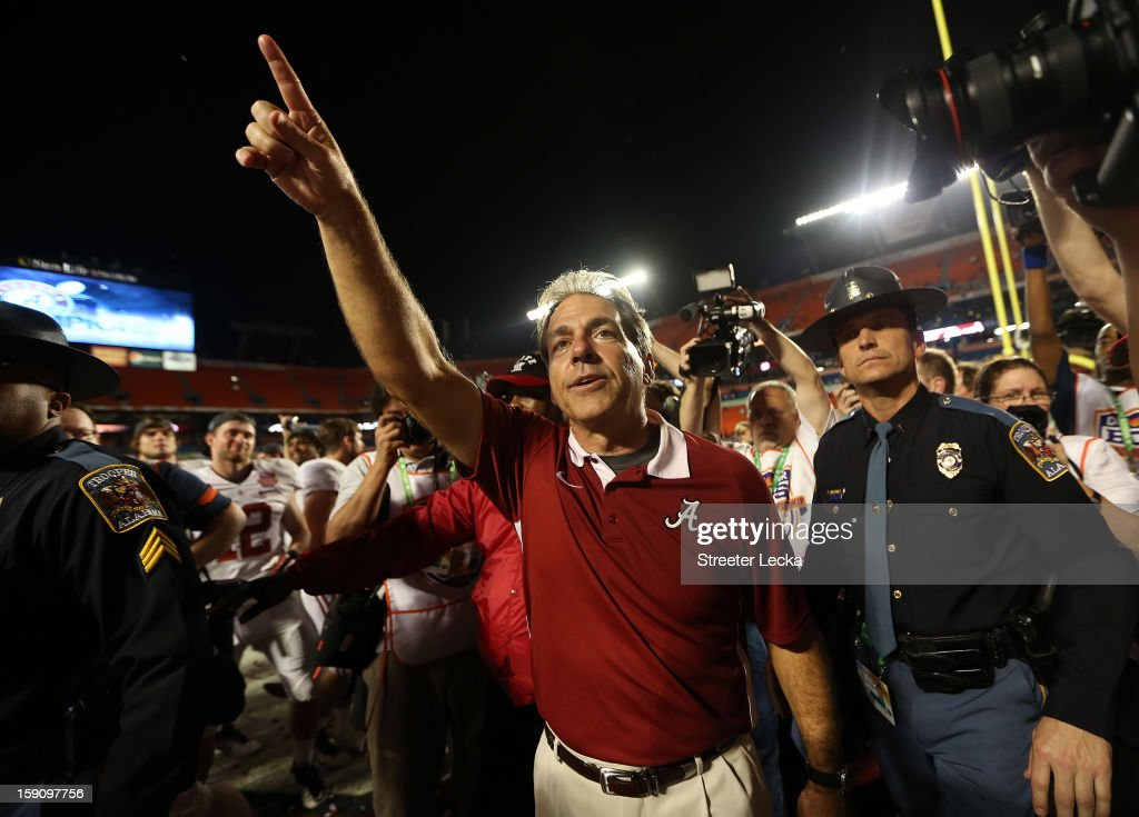 Head coach <a gi-track='captionPersonalityLinkClicked' href=/galleries/search?phrase=Nick+Saban&family=editorial&specificpeople=242860 ng-click='$event.stopPropagation()'>Nick Saban</a> of the Alabama Crimson Tide celebrates defeating the Notre Dame Fighting Irish in the 2013 Discover BCS National Championship game at Sun Life Stadium on January 7, 2013 in Miami Gardens, Florida. Alabama won the game by a score of 42-14.