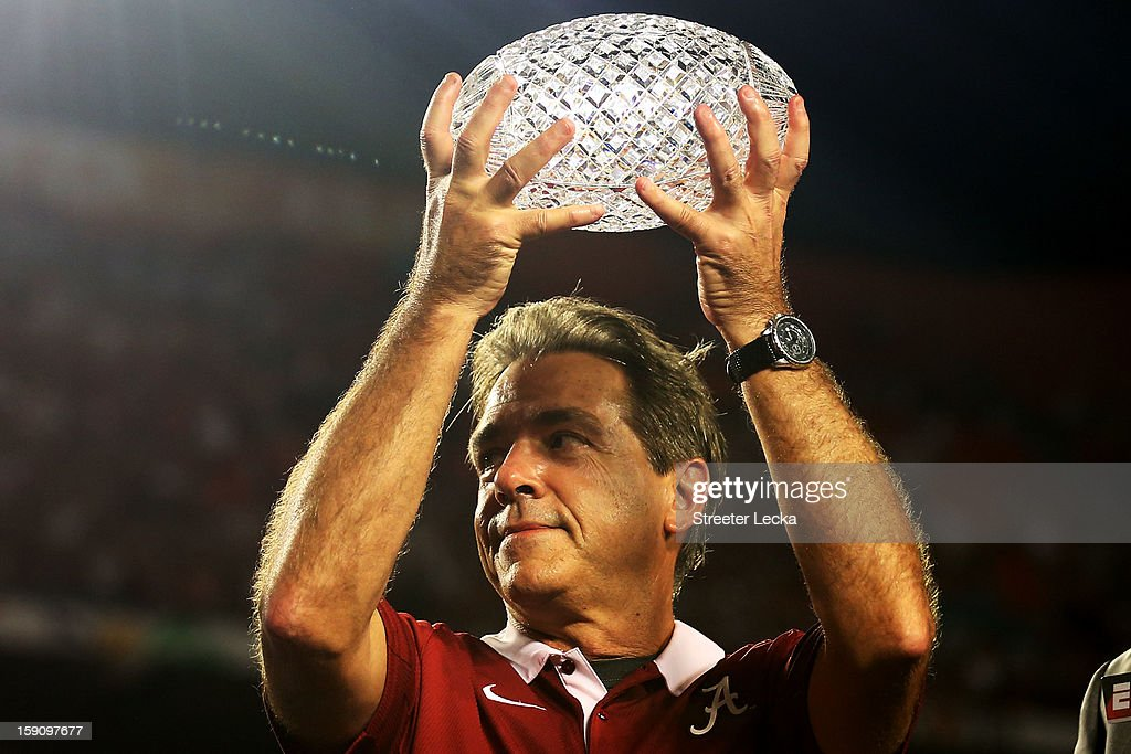 Head coach Nick Saban of the Alabama Crimson Tide celebrates with the trophy after defeating the Notre Dame Fighting Irish in the 2013 Discover BCS National Championship game at Sun Life Stadium on January 7, 2013 in Miami Gardens, Florida. Alabama won the game by a score of 42-14.