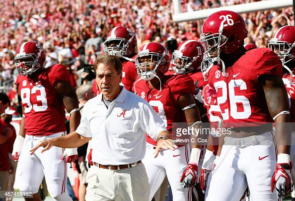 Head coach Nick Saban of the Alabama Crimson Tide leads his team onto the field prior to facing the Texas AM Aggies at BryantDenny Stadium on October...