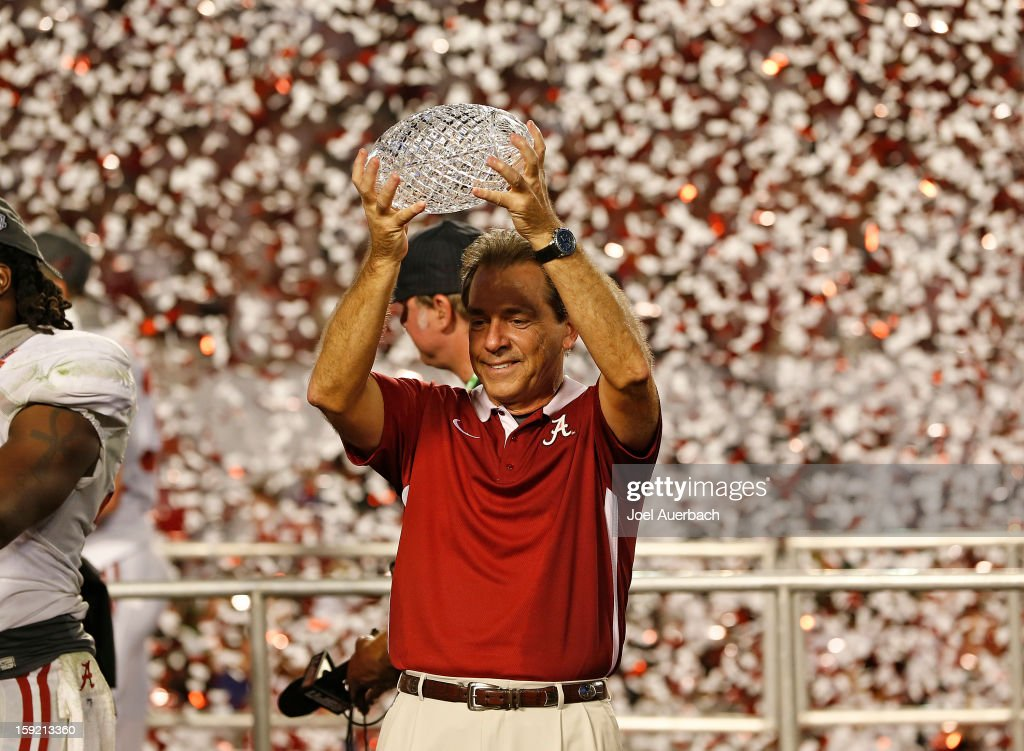 Head coach Nick Saban of the Alabama Crimson Tide lifts the Coaches' Trophy after defeating the Notre Dame Fighting Irish during the 2013 Discover BCS National Championship Game at Sun Life Stadium on January 7, 2013 in Miami Gardens, Florida. Alabama defeated Notre Dame 42-14.
