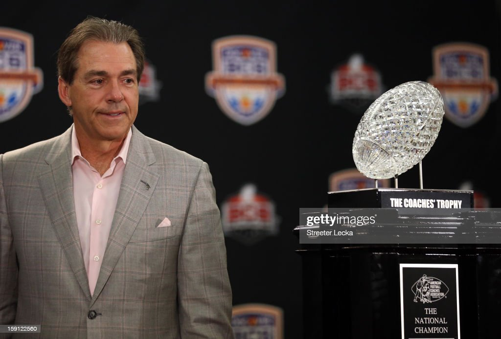 Head coach <a gi-track='captionPersonalityLinkClicked' href=/galleries/search?phrase=Nick+Saban&family=editorial&specificpeople=242860 ng-click='$event.stopPropagation()'>Nick Saban</a> of the Alabama Crimson Tide looks at the National Championship trophy during the Discover BCS National Championship Press Conference at the Harbor Beach Marriott on January 8, 2013 in Fort Lauderdale, Florida.