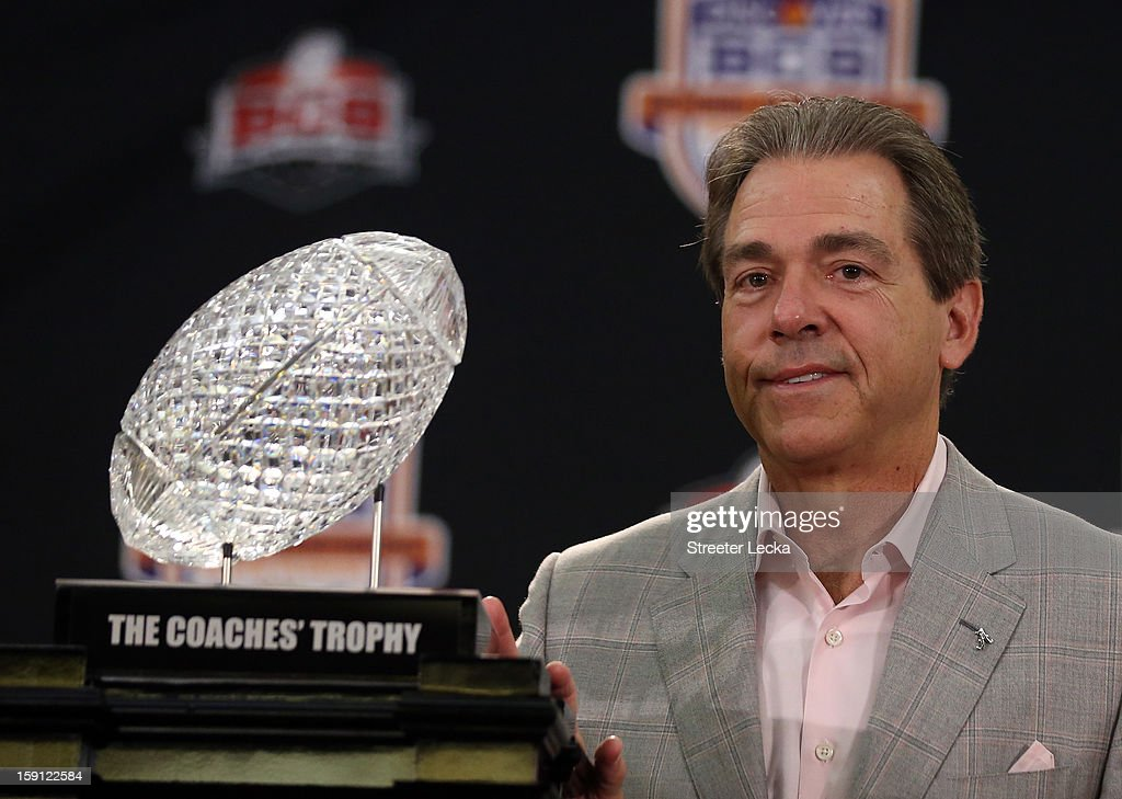 Head coach Nick Saban of the Alabama Crimson Tide poses with the National Championship trophy during the Discover BCS National Championship Press Conference at the Harbor Beach Marriott on January 8, 2013 in Fort Lauderdale, Florida.