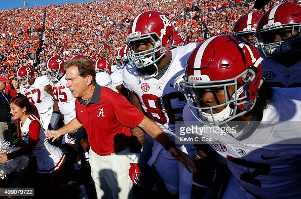 Head coach Nick Saban of the Alabama Crimson Tide prepares to lead his team onto the field to face the Alabama Crimson Tide at Jordan Hare Stadium on...