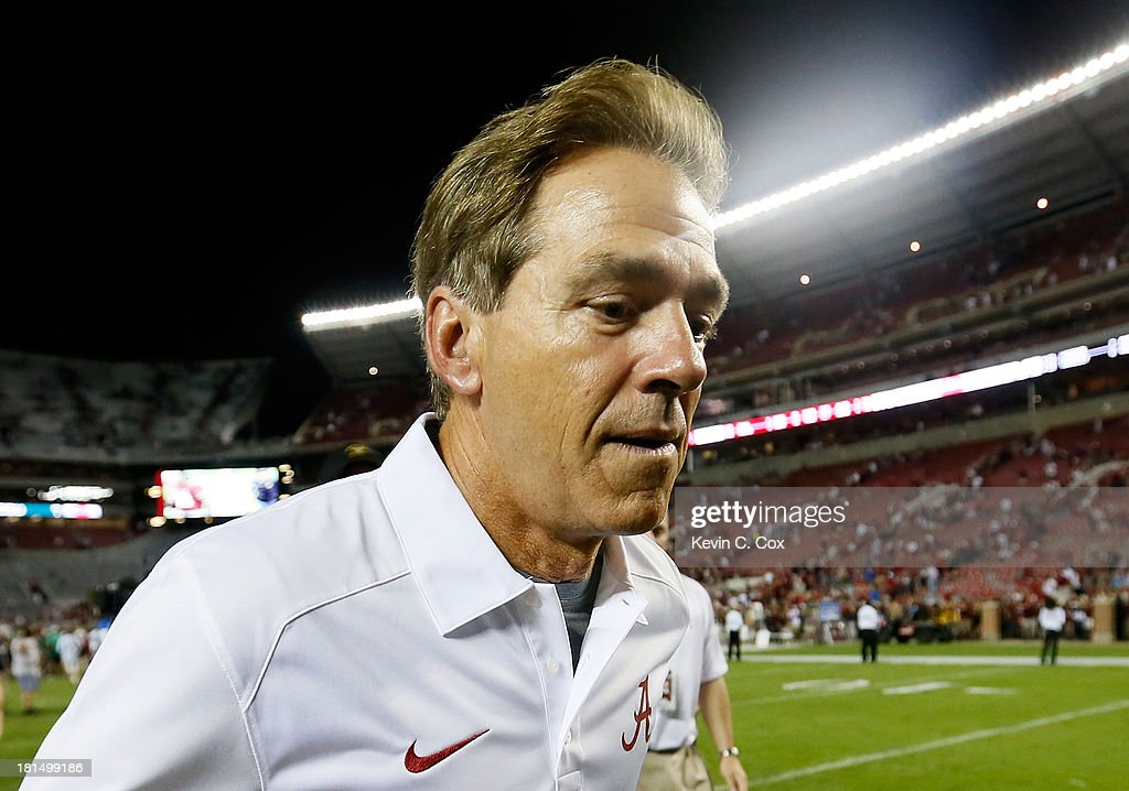Head coach <a gi-track='captionPersonalityLinkClicked' href=/galleries/search?phrase=Nick+Saban&family=editorial&specificpeople=242860 ng-click='$event.stopPropagation()'>Nick Saban</a> of the Alabama Crimson Tide runs off the field after their 31-6 win over the Colorado State Rams at Bryant-Denny Stadium on September 21, 2013 in Tuscaloosa, Alabama.