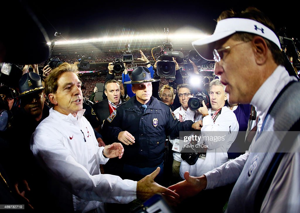 Head coach <a gi-track='captionPersonalityLinkClicked' href=/galleries/search?phrase=Nick+Saban&family=editorial&specificpeople=242860 ng-click='$event.stopPropagation()'>Nick Saban</a> of the Alabama Crimson Tide shakes hand with head coach <a gi-track='captionPersonalityLinkClicked' href=/galleries/search?phrase=Gus+Malzahn&family=editorial&specificpeople=3950993 ng-click='$event.stopPropagation()'>Gus Malzahn</a> of the Auburn Tigers after the Iron Bowl at Bryant-Denny Stadium on November 29, 2014 in Tuscaloosa, Alabama. The Alabama Crimson Tide defeated the Auburn Tigers 55 to 44.