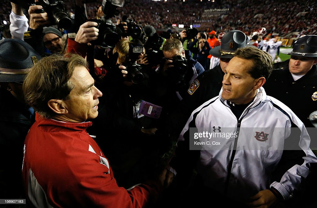 Head coach Nick Saban of the Alabama Crimson Tide shakes hands with head coach Gene Chizik of the Auburn Tigers after their 49-0 win at Bryant-Denny Stadium on November 24, 2012 in Tuscaloosa, Alabama.