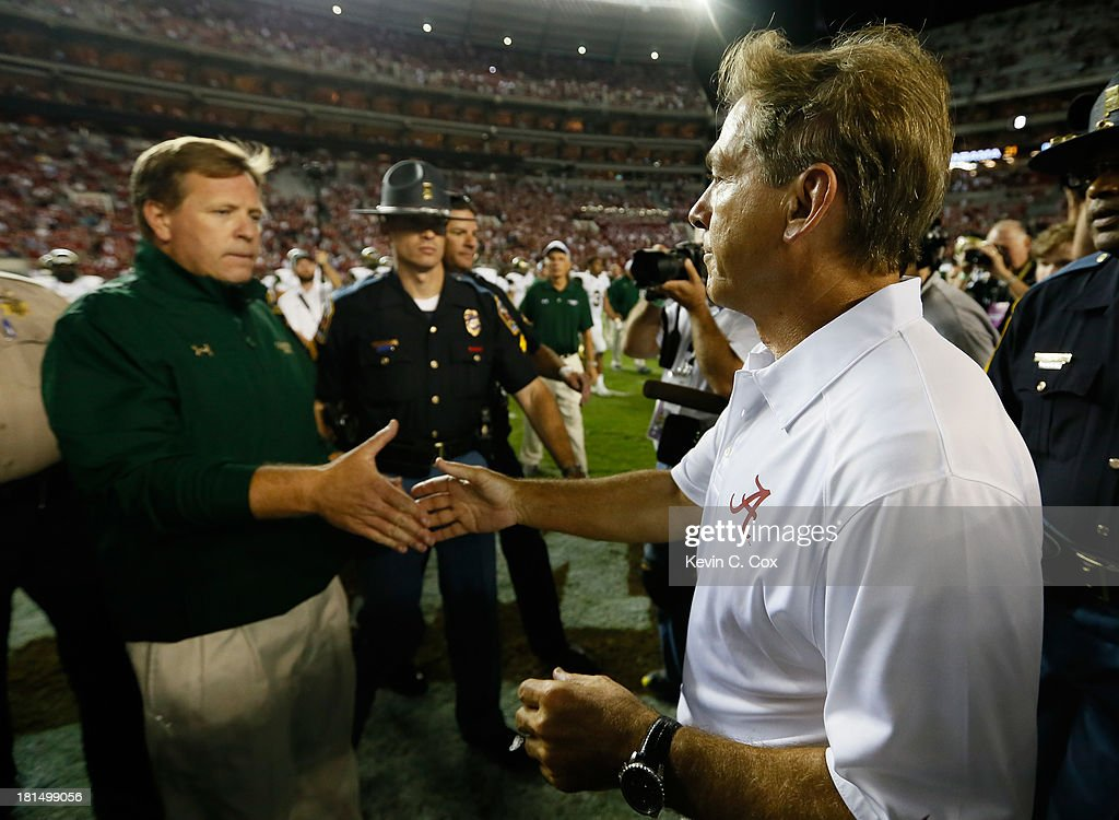 Head coach <a gi-track='captionPersonalityLinkClicked' href=/galleries/search?phrase=Nick+Saban&family=editorial&specificpeople=242860 ng-click='$event.stopPropagation()'>Nick Saban</a> of the Alabama Crimson Tide shakes hands with head coach <a gi-track='captionPersonalityLinkClicked' href=/galleries/search?phrase=Jim+McElwain&family=editorial&specificpeople=748949 ng-click='$event.stopPropagation()'>Jim McElwain</a> of the Colorado State Rams after their 31-6 win at Bryant-Denny Stadium on September 21, 2013 in Tuscaloosa, Alabama.
