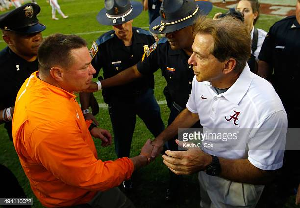 Head coach Nick Saban of the Alabama Crimson Tide shakes hands with head coach Butch Jones of the Tennessee Volunteers after their 1914 win at...