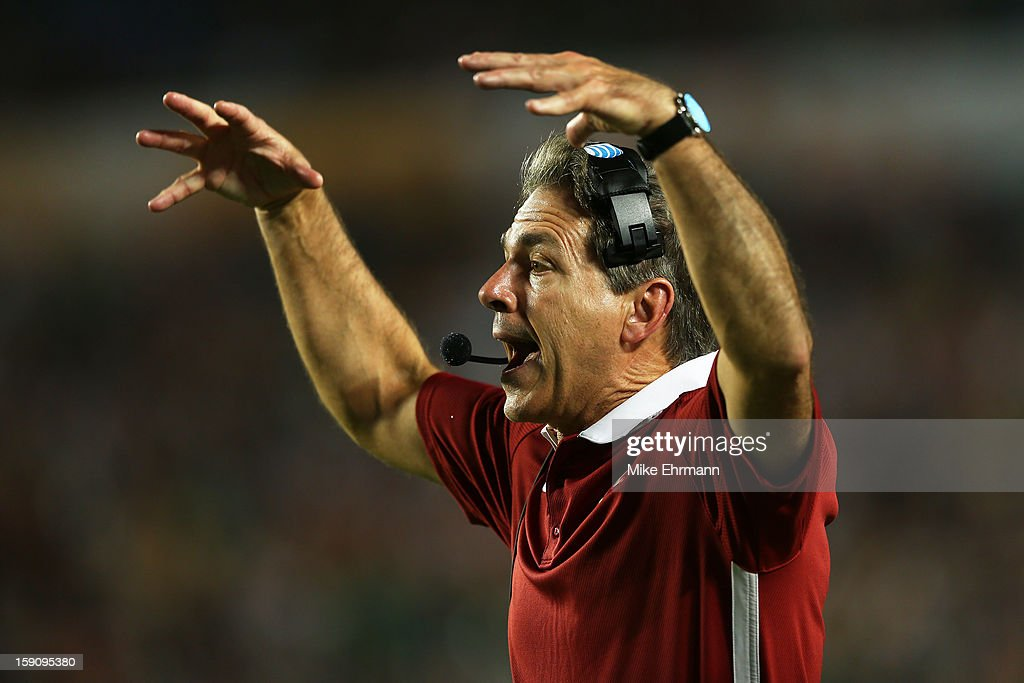 Head coach <a gi-track='captionPersonalityLinkClicked' href=/galleries/search?phrase=Nick+Saban&family=editorial&specificpeople=242860 ng-click='$event.stopPropagation()'>Nick Saban</a> of the Alabama Crimson Tide shouts to his players during the 2013 Discover BCS National Championship game against the Notre Dame Fighting Irish at Sun Life Stadium on January 7, 2013 in Miami Gardens, Florida.