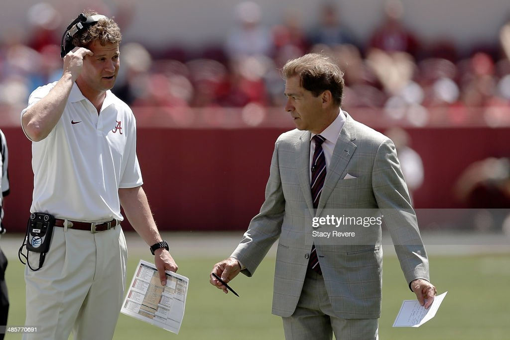 Head coach Nick Saban of the Alabama Crimson Tide speaks with offensive coordinator Lane Kiffin during the Alabama ADay spring game at BryantDenny...