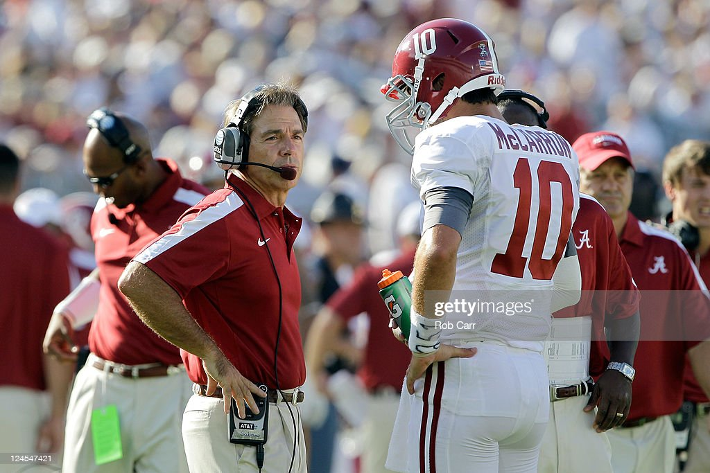 Head coach <a gi-track='captionPersonalityLinkClicked' href=/galleries/search?phrase=Nick+Saban&family=editorial&specificpeople=242860 ng-click='$event.stopPropagation()'>Nick Saban</a> of the Alabama Crimson Tide talks with quarterback AJ McCarron #10 during the scond half against the Penn State Nittany Lions at Beaver Stadium on September 10, 2011 in State College, Pennsylvania.