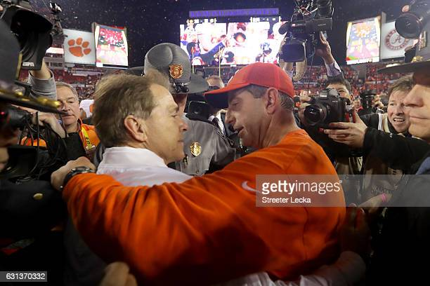 Head coach Nick Saban of the Alabama Crimson Tide talks with head coach Dabo Swinney of the Clemson Tigers after the Tigers defeated the Crimson Tide...