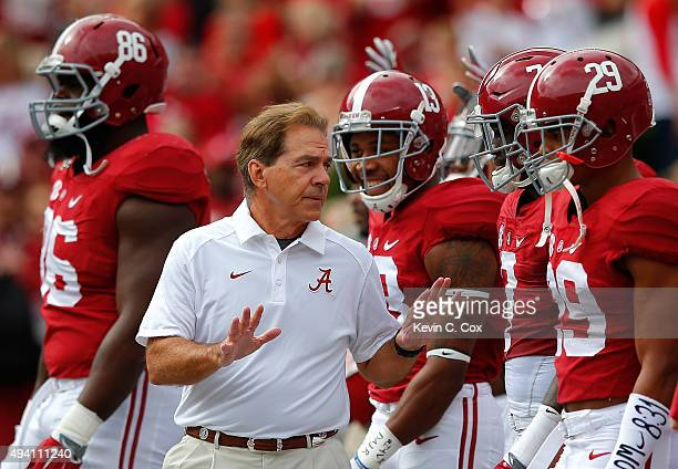 Head coach Nick Saban of the Alabama Crimson Tide walks his team onto the field prior to facing the Tennessee Volunteers at BryantDenny Stadium on...