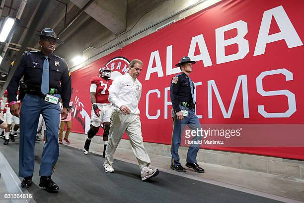 Head coach Nick Saban of the Alabama Crimson Tide walks through the tunnel before taking on the Clemson Tigers in the 2017 College Football Playoff...