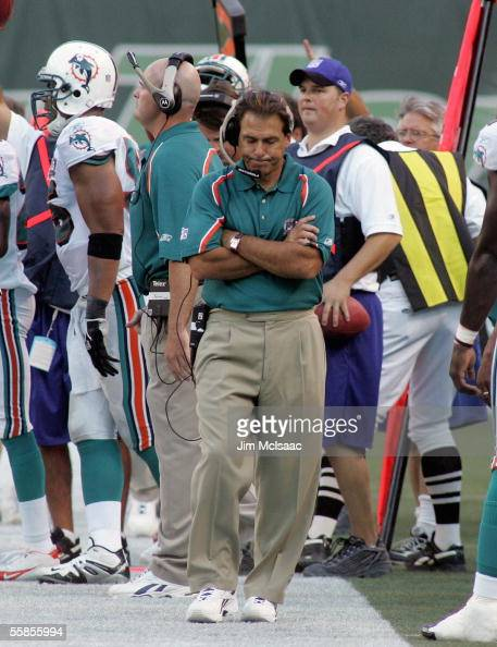 Head coach Nick Saban of the Miami Dolphins walks on the sidelines against the New York Jets during their game on September 18 2005 at Giants Stadium...