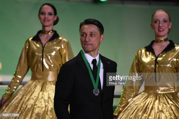 Head coach Nico Kovac of Eintracht Frankfurt shows dejection at the medal ceremony after the DFB Cup Final match between Eintracht Frankfurt and...