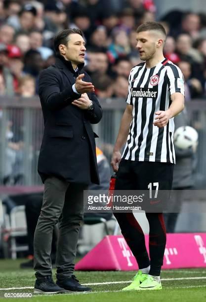 Head coach Nico Kovac of Frankfurt speaks with Ante Rebic of Frankfurt during the Bundesliga match between Bayern Muenchen and Eintracht Frankfurt at...