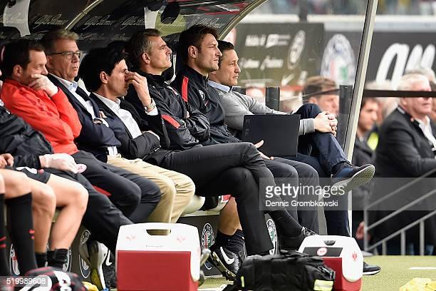 Head coach Niko Kovac and assistant coach Robert Kovac of Eintracht Frankfurt look on during the Bundesliga match between Eintracht Frankfurt and...