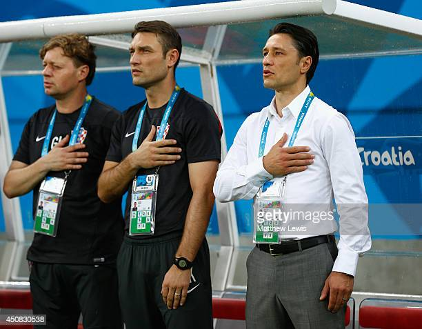 Head coach Niko Kovac of Croatia looks on during the National Anthem with assistant coach Robert Kovac prior to the 2014 FIFA World Cup Brazil Group...