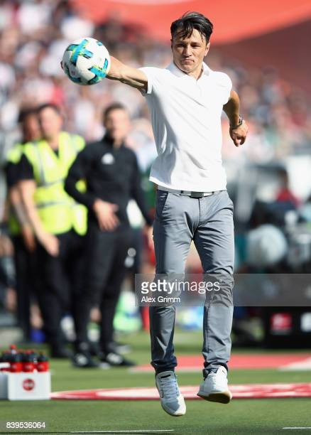 Head coach Niko Kovac of Frankfurt catches the ball during the Bundesliga match between Eintracht Frankfurt and VfL Wolfsburg at CommerzbankArena on...