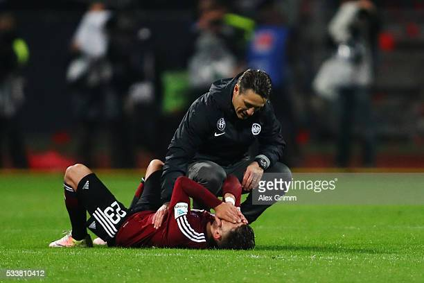Head coach Niko Kovac of Frankfurt consoles Daniel Candeias of Nuernberg after the Bundesliga Playoff Leg 2 between 1 FC Nuernberg and Eintracht...