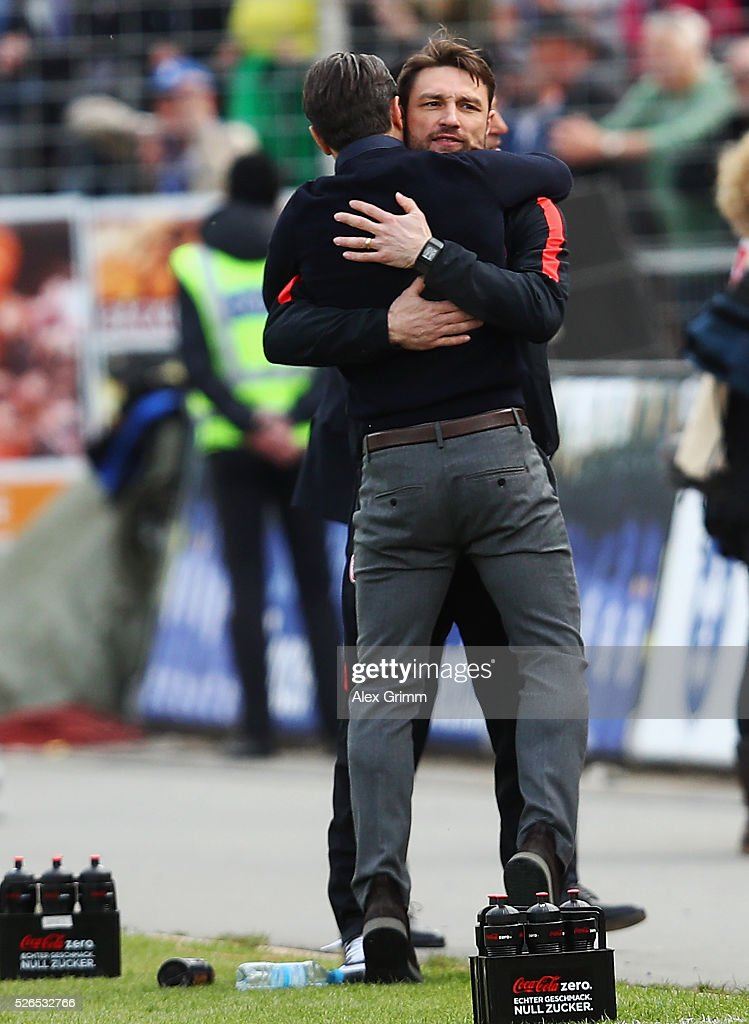 Head coach Niko Kovac of Frankfurt hugs his brother Robert after the Bundesliga match between SV Darmstadt 98 and Eintracht Frankfurt at Merck-Stadion am Boellenfalltor on April 30, 2016 in Darmstadt, Hesse.