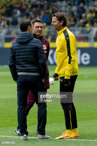 Head coach Niko Kovac of Frankfurt Robert Kovac speak with Goalkeeper Roman Weidenfeller of Dortmund during the Bundesliga match between Borussia...
