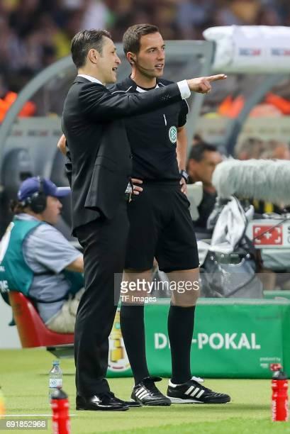 Head coach Niko Kovac of Frankfurt speak with Benjamin Brand during the DFB Cup final match between Eintracht Frankfurt and Borussia Dortmund at...