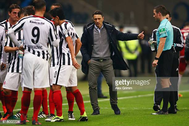 Head coach Niko Kovac of Frankfurt talks to referee Harm Osmers during the DFB Cup Second Round match between Eintracht Frankfurt and FC Ingolstadt...